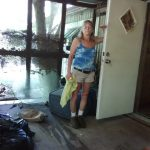 Woman in flood damaged home